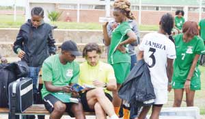 •FREE TIPS....Chipolopolo boss, Patrice Beaumelle exchanges notes with Zambia women team coach Charles Bwale after a training session at the Olympic Youth Development Centre in Lusaka in readiness for next weekend's African Women Championship qualifier against Tanzania. Picture by SHAMAOMA MUSONDA