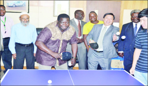 •SPORTS Minister Chishimba Kambwili and Chinese Ambassador to Zambia, Zhou Yaxiao test their ping-pong skills after China donated assorted sports equipment to the Zambia Table Tennis Association (ZTTA) in Lusaka yesterday. Picture by CLEVER ZULU