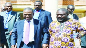 •JUSTICE Minister Wynter Kabimba (left) walks hand-in-hand with former Solwezi Central Member of Parliament Lucky Mulusa at the Supreme Court building in Lusaka yesterday after attending the opening of the Tribunal appointed to investigate him. Picture by STEPHEN KAPAMBWE