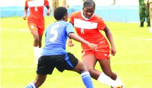 • ZAMBIA'S Hellen Mubanga (right) beats Fatuma Issa of Tanzania during the 2015 Africa Women Championship qualifier at Nkoloma Stadium in Lusaka yesterday. Zambia won 2-1. Picture by CLEVER ZULU