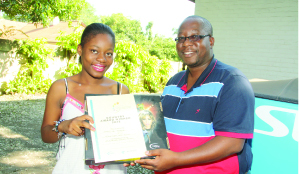 • First Zambian finalist in the DStv  Eutelsat Star Awards, Francine Mazala (left)  with Multichoice public relations manager Marlon Kananda.