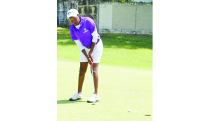 •GOING FOR A BIRDIE......LOCAL player, Lorna Mwenda putts on the ninth green during the second round of the Zambia Professional Ladies Open Golf Championship in Ndola yesterday. Picture by FELIX MALUNGA.