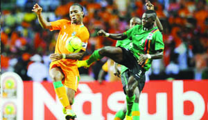 •FLASHBACK.....IVORY Coast striker, Didier Drogba (left) challenged by Zambian midfielder, Chisamba Lungu during the 2012 Africa Cup of Nations final match in Gabon. Zambia beat Ivory Coast on penalties to lift the continental trophy. Picture by MTN