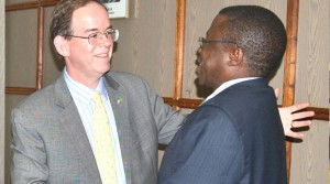 • Foreign Affairs Deputy Minister Gabriel Namulambe (right) talks to American Embassy Chargé d'Affaires David Young after a closed-door meeting at the ministry of Foreign Affairs in Lusaka recently. Picture by STEPHEN KAPAMBWE.