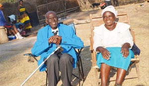 •MR Hatyoka and his wife Elizabeth, outside their house in Hamukanchali Village in Monze during his 100th birthday celebrations.