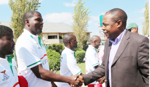 • FOOTBALL Association of Zambia president, Kalusha Bwalya (right) greets his former Chipolopolo teammate Elijah Litana during the CAF 'C' Licence coaching clinic in Lusaka yesterday. Litana is one of the coaches attending the programme. Picture by JEAN MANDELA