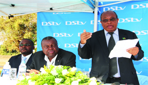 • Education Minister John Phiri addresses pupils during the MultiChoice presentation of education kit in Chilenje, Lusaka. With him is MultiChoice General Manager Simon Bota (centre) and Acting MultiChoice public relations manager Mumbi Mutale (left).