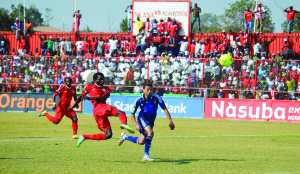 • NKANA striker Ronald Kampamba (Centre) shoots the ball under pressure from Al Ahly defender Saad Samir during the Orange CAF Confederation Cup group B match at Nkana Stadium in Kitwe yesterday. Picture by KALUMIANA KALUMIANA