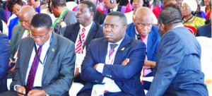 • Foreign Affairs Minister Harry Kalaba (middle) with Zambia's Commerce, Trade and Industry Minister Bob Sichinga  (far left in rear seat), follow proceedings at the 34th ordinary Summit of the SADC Heads of State and Government in Zimbabwe's Victoria Falls yesterday. (Inset) Vice-President Guy Scott is leading the Zambian delegation. Picture by BRIAN HATYOKA