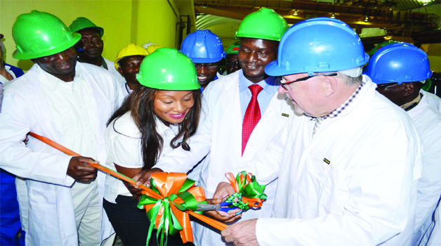 • VICE-PRESIDENT Guy Scott (right) being helped to cut the ribbon by Zesco marketing officer Mwika Tambatamba during the  handover ceremony of the Kariba North Bank extension power project in Siavonga yesterday, as managing director Cyprian Chitundu (left) and Energy and Mines Deputy Minister Richard Musukwa look on. Picture by CLEVER ZULU