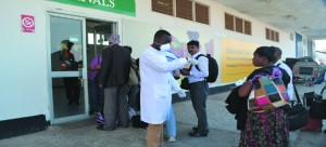 A HEALTH official gets information from a passenger who had just disembarked an international flight at the Simon Mwansa Kapwepwe International Airport in Ndola yesterday. The process is part of screening for Ebola at entry points into Zambia. Picture by REBECCA MUSHOTA