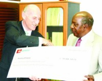 • FINANCE Minister Alexander Chikwanda (right) receives a dummy cheque from Zanaco managing director Bruce Dick at the Ministry of Finance in Lusaka yesterday. Picture by CLEVER ZULU