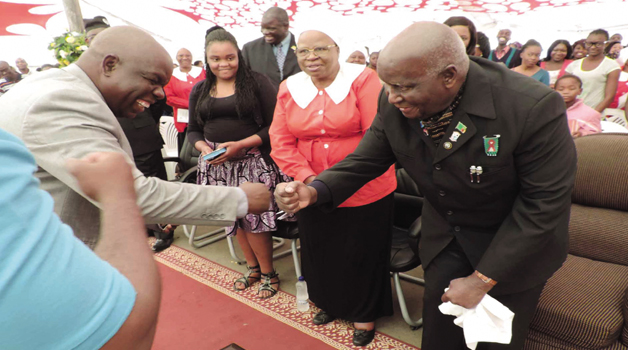 • First Republican President Dr Kenneth Kaunda (right) is welcomed by Trinity United Church of Zambia Reverend Lloyd Sikaundi (left) as Chief Justice Lombe Chibesakunda looks on at a fundraising Sunday service in Lusaka yesterday. (See story on Page 2)  Picture by STEPHEN KAPAMBWE