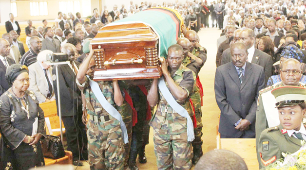 • PALLBEARERS carry the casketfor the late freedom fighter Peter Matoka during the requiem mass at the New Apostolic Church in Lusaka yesterday. Picture by CLEVER ZULU