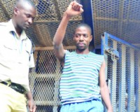 • MUFUMBWE Member of Parliament Steven Masumba flashes the PF party symbol after climbing onto a Zambia Police truck, enroute to prison, after the Lusaka High Court upheld his 12-month jail sentence for forging an accounting technician diploma in Lusaka yesterday. Picture by CHUSA SICHONE