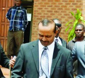 • Game Stores Zambia manager Maduramuthoo Mare Palan (centre) leaves the Lusaka Magistrates Court complex in Lusaka yesterday. Picture by STEPHEN KAPAMBWE