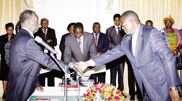 • PRESIDENT Michael Sata (left)congratulates new Supreme Court Judge Mumba Malila during a swearing-in ceremony at State House in Lusaka Yesterday. Picture by THOMAS NSAMA