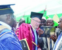 """• VICE-President Guy Scott (left) poses for a photo popularly known as """"Selfie"""" with one of the students who was graduating at the National Institute for Public Administration (NIPA) 15th graduation ceremony in Lusaka yesterday. Picture by CHUSA SICHONE."""