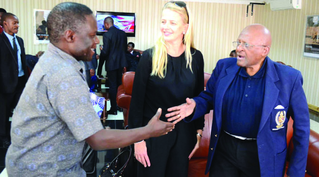 • GIRLS Not Brides, founder Archbishop Desmond Tutu (right) greets Deputy Inspector General of Police Solomon Jere (left) on arrival at Kenneth Kaunda International Airport. Looking on is Princess Mabel van Oranje. Picture by CLEVER ZULU.