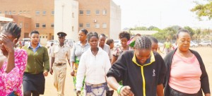 • BISHOP Rose Kayanda (right), of Jesus Soul Ministries, and her followers being led to Lusaka Central Prison after appearing in court yesterday. They are accused of beating up magistrate Exildah Chanda and her husband Rabison. Picture by NAKUBIANA SHABONGO