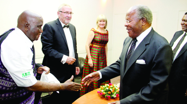 •FIRST Republican president Dr Kenneth Kaunda welcomes former Malawian president Bakili Muluzi to Hotel Inter-Continental in Lusaka for the Golden Jubilee State Banquet last night. Looking on is Vice-President Guy Scott and his wife Charlotte. Picture by THOMAS NSAMA