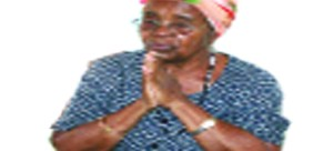 • MRS Salome Kapwepwe recalls some events. (Background) MR Kapwepwe's  picture hangs on  the wall.