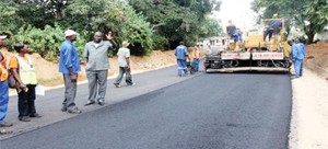 •WORKERS busy at work on one of the Link Zambia 8000 road projects.