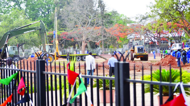 • WORKS to prepare the burial site for late President Michael Sata at Embassy Park in Lusaka have started. (Below) Lusaka City Market traders from Eastern Province yesterday powdered their 'tribal cousins' from Northern Province as part of mourning.  Pictures by CHUSA SICHONE