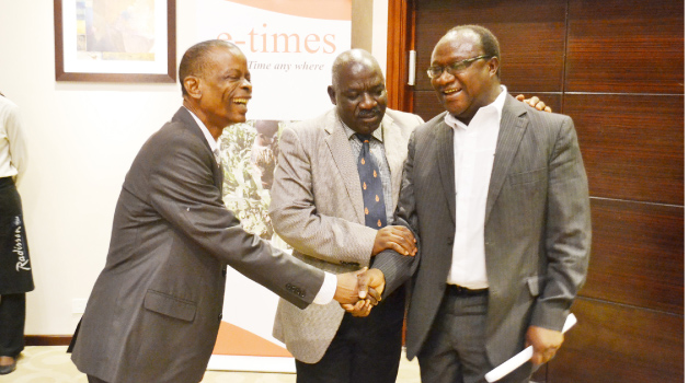 • INFORMATION and Broadcasting Services Minister Joseph Katema (left), Permanent Secretary Bert Mushala (centre) and Times Printpak Board chairperson Michael Musonda during the launch of the e-Times at Radisson Blu Hotel in Lusaka. Picture by STEPHEN KAPAMBWE
