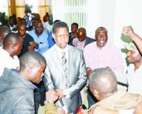 •PF Secretary General Edgar Lungu surrounded by party members as he leaves Government Complex yesterday after a Central Committee meeting.
