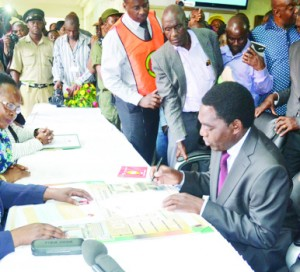 • UNITED Party for National Development president Hakainde Hichilema (second right) flanked by his wife Mutinta (right) filing his presidential nomination papers as acting Chief Justice Lombe Chibesakunda (centre, left) and Electoral Commission of Zambia chairperson Ireen Mambilima (third left) look on at the Supreme Court in Lusaka yesterday. UNIP president Tilyenji Kaunda and