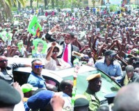• PATRIOTIC Front presidential candidate Edgar Lungu and wife Esther wave to supporters through the sun-roof of the car on arrival at the Supreme Court grounds yesterday. Mr Lungu later filed his nomination.