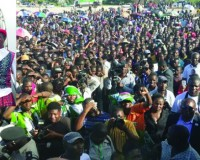 • Part of the crowd which attended the rally in Mongu yesterday.  (Inset)  PATRIOTIC Front presidential candidate, Edgar Lungu with party chairperson Inonge Wina alight from a plane for a campaign rally in Mongu yesterday.