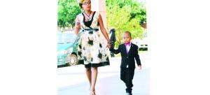 • How cute isMukuka Chilufya Jr escorting his mumJanet Simwanza - Chilufya. Notice the purple and the little pink bow tie