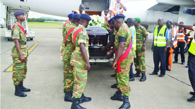 • ZAMBIA Army pallbearers prepare to lift late Willie Nsanda's casket from a South African Airways plane at Simon Mwansa Kapwepwe International Airport in Ndola yesterday.  Picture by JAMES KUNDA