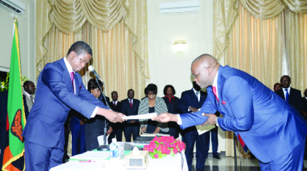 • PRESIDENT Edgar Lungu (left) receives an affidavit from Attorney General Likando Kalaluka during a swearing- in ceremony at State House in Lusaka yesterday. Picture by CLEVER ZULU
