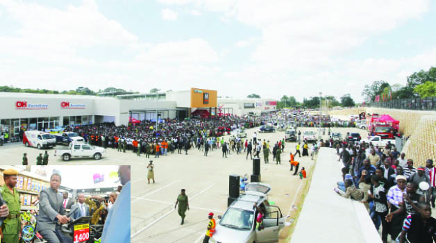 • RESIDENTS throng the Mukuba Mall in Kitwe that was commissioned yesterday by President Edgar Lungu. Inset, President Lungu feels of one of the exercise bicycles during the official opening of Mall yesterday. Pictures by MOFFAT CHAZINGWA and SALIM HENRY/State House