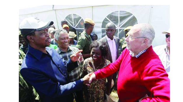 • PRESIDENT  Edgar Lungu (left) talks to former vice-  president Guy Scott in Chisamba yesterday during the Agritech Expo Zambia 2015. Picture by  SALIM HENRY/STATE HOUSE