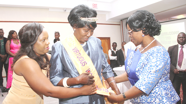 • FIRST Lady Esther Lungu (right)  conferring the 2015 Virtuous Woman Award on Vice-President Inonge Wina (centre) during the Generation Impact Foundation Trust Virtuous Women Awards ceremony at Pamodzi Hotel on Saturday. -Picture by THOMAS NSAMA