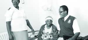 • The 110-year-old Miliya Chimanga flanked by Salvation Army's Major Harriet Mwiiga and Major Adeck Mwiinga  in her room at Mitanga Home for the Aged.