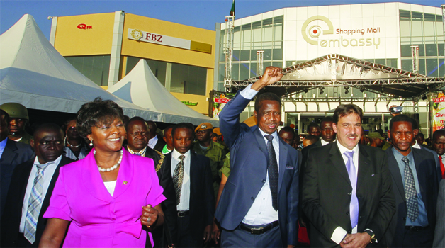 • President Edgar Lungu (centre) flanked by Commerce Trade and Industry Minister Margaret Mwanakatwe (left) and Clicks Zambia Limited director Aki Vasilakopoulos after the official opening of Embassy Shopping Mall in Chawama in Lusaka yesterday. Picture By SALIM HENRY