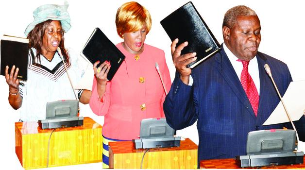 • NEWLY Elected Mulobezi MP Patricia Mulasinkwanda (left), Petauke Central's Dora Siliya and Malambo's Jacob Shuma take oath in Parliament yesterday.