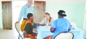 • UNITED States-based Orphan Medical Network International doctors are on the Copperbelt to provide health services to the less privileged. Above, the doctors attending to a resident of Ndola's Mckenzie Township yesterday. Picture by MILDRED KATONGO.
