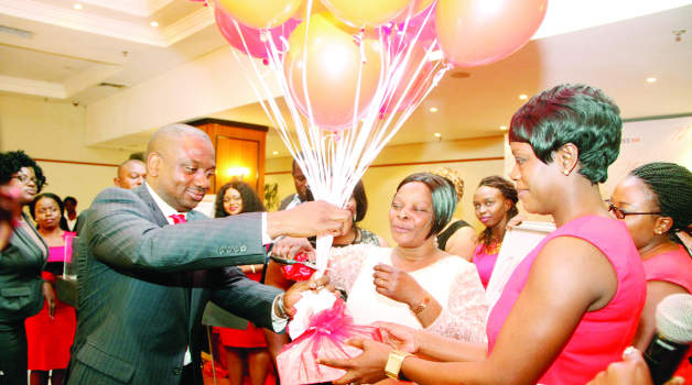 •FIRST Lady Esther Lungu (C) frees balloons to mark the official launch of the Women Banking Initiative assisted by Access Bank managing director Tunde Balogun (L) and the bank's head - corporate communications Tabitha Mvula (R) at Pamodzi Hotel in Lusaka on Friday. -Picture by THOMAS NSAMA/STATE HOUSE
