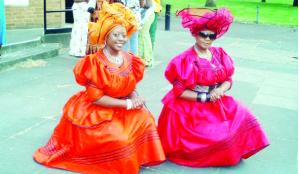 •Women clad in Musisi attire.