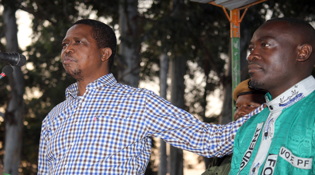 • PRESIDENT Edgar Lungu (left) introduces Patriotic Front candidate Anthony Kasandwe to the crowd when he addressed a public rally in Samfya yesterday to drum up support ahead of this Thursday's by-election in Bangweulu Constituency.  Picture by EDDIE MWANALEZA/STATE HOUSE