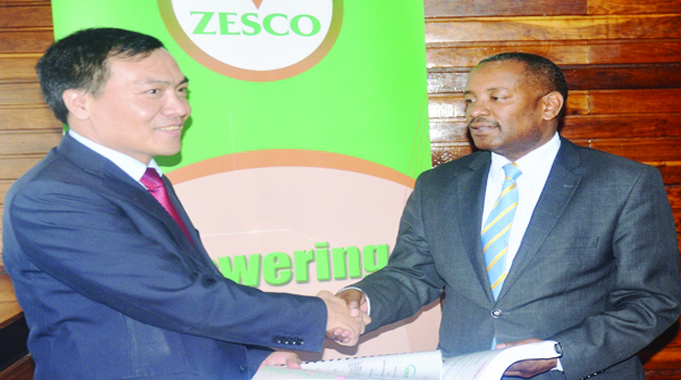 •ZESCO acting managing director Victor Mundende (right) exchanges documents with Sinohydro Corporation Limited vice-president Liu Kai. This was during the signing of a contract for the construction of the Kafue Gorge Lower hydro power plant. Picture by JAMES KUNDA
