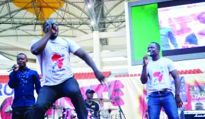 •Matthew (centre) and his brother Hezron Ngosa (right) perform during the CHAPRO  Africa Unite concert at Heros Stadium last weekend.picture by christine mwaaba