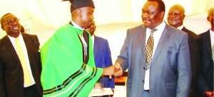 •Times Printpak Managing Director Bestone Ng'onga congratulates ZAMCOM 2010-2012 intake  Best Student Joe Pandwe.