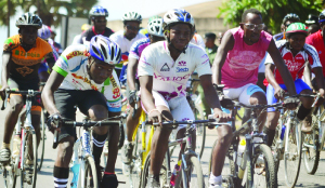 •CYCLISTS vie for honours during the Mazabuka bike race competition. (Inset) Winner Obert Chembe lifted by his supporters and fellow cyclists after winning the race. Picture by GWEN CHIPASULA